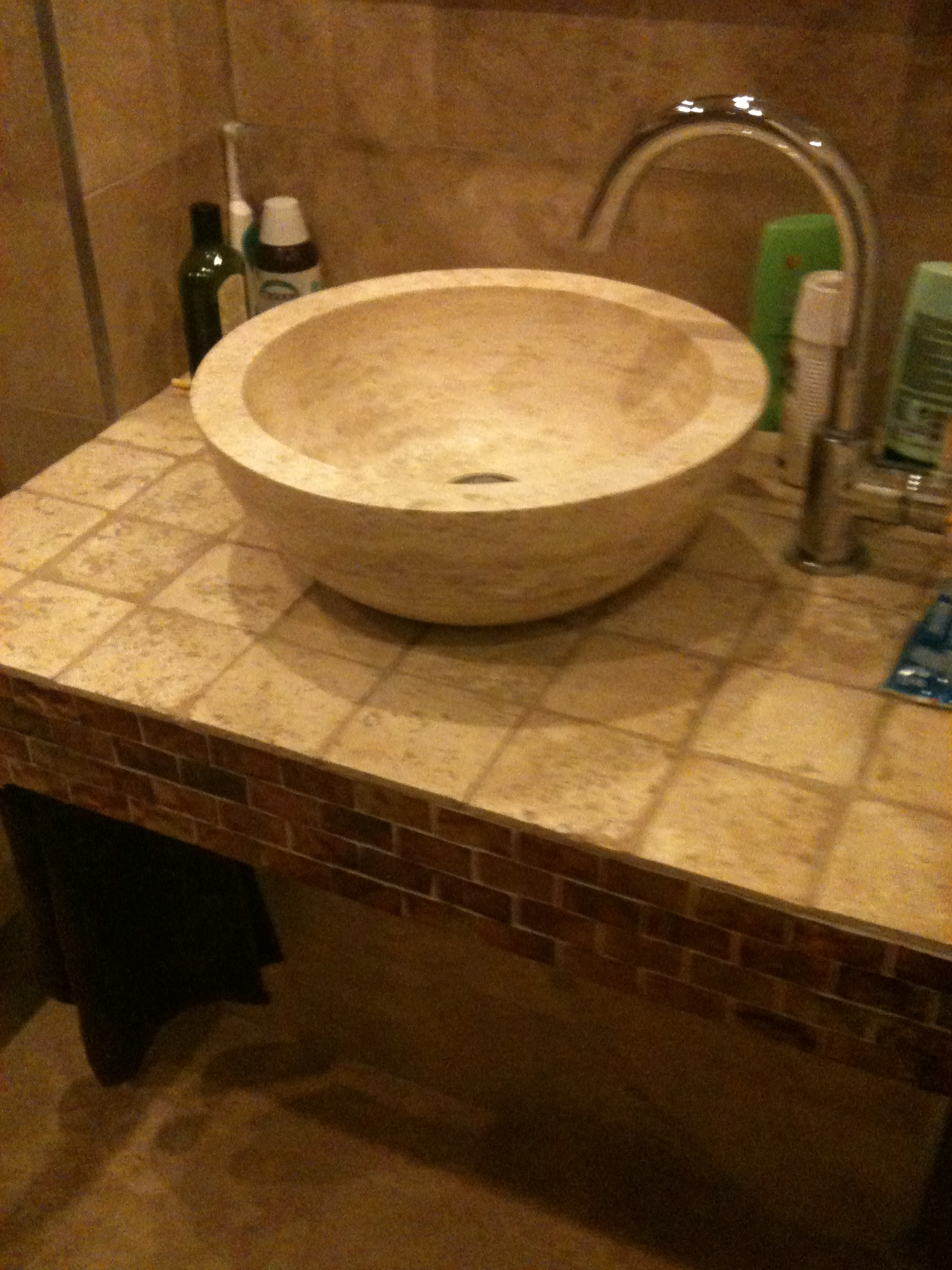 Here is a travertine sink on a stand that i built and tiled