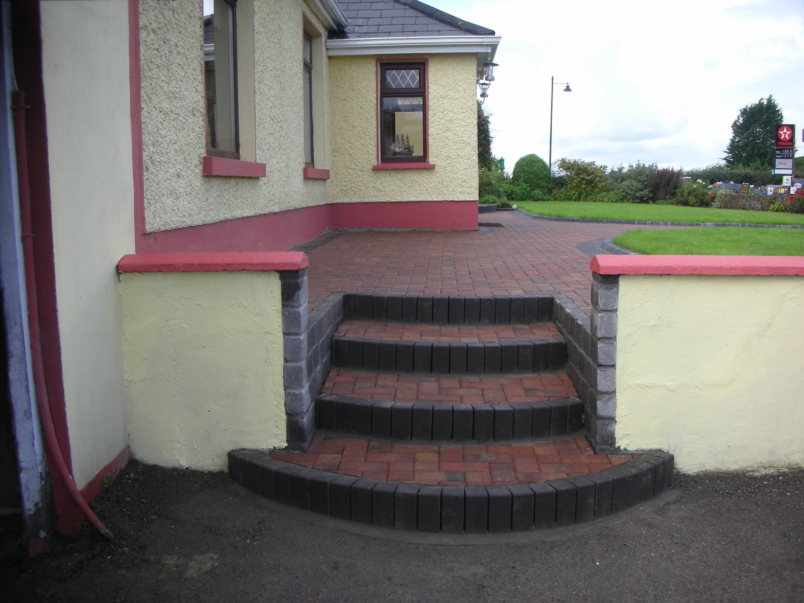 Paved steps with contrasting Charcoal  Brick edging 