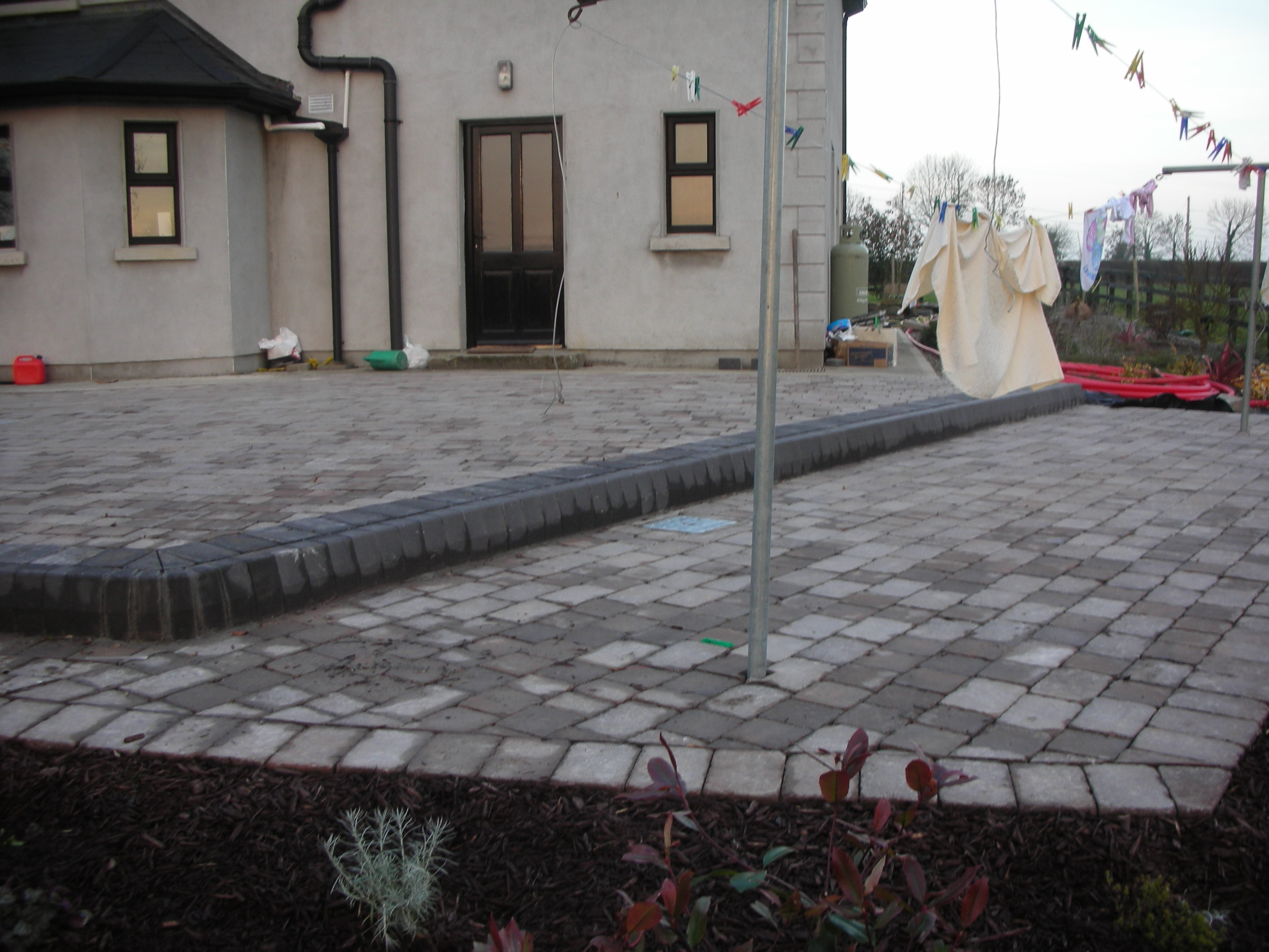 Brick Paving & steps with a charcoal edging brick