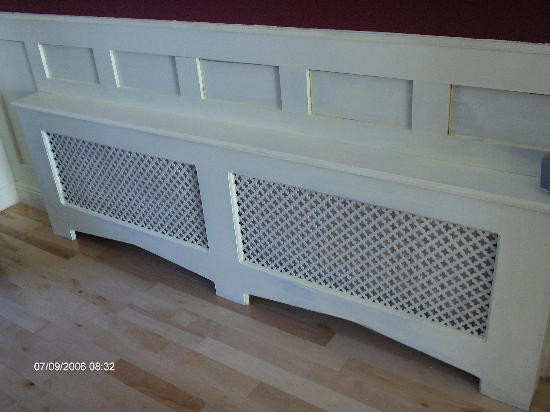 Purpose build radiator cover and wall panelling to match, and solid birch flooring,