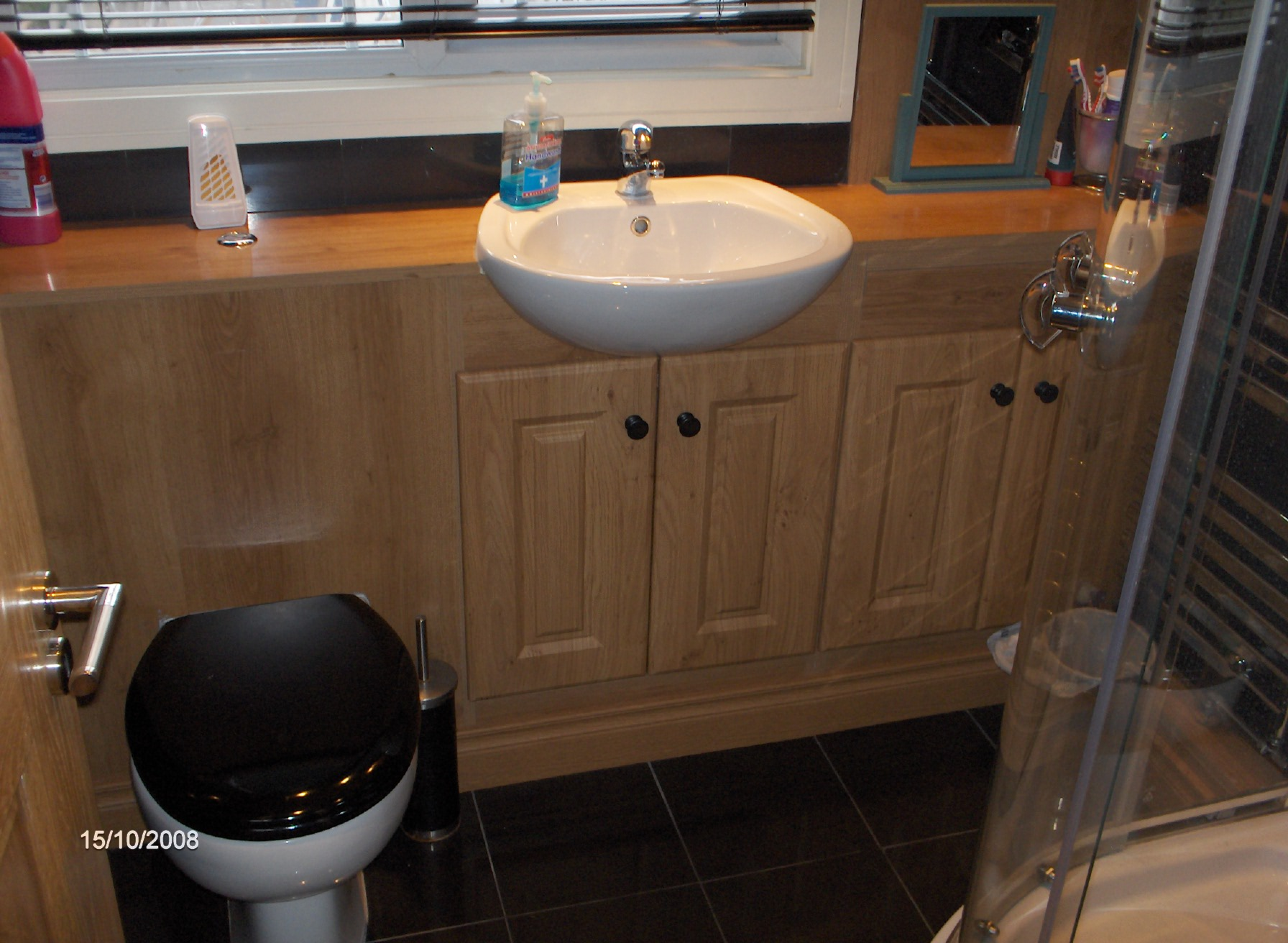 Bathroom with concealed cistern , under sink storage units, and recessed sink ,