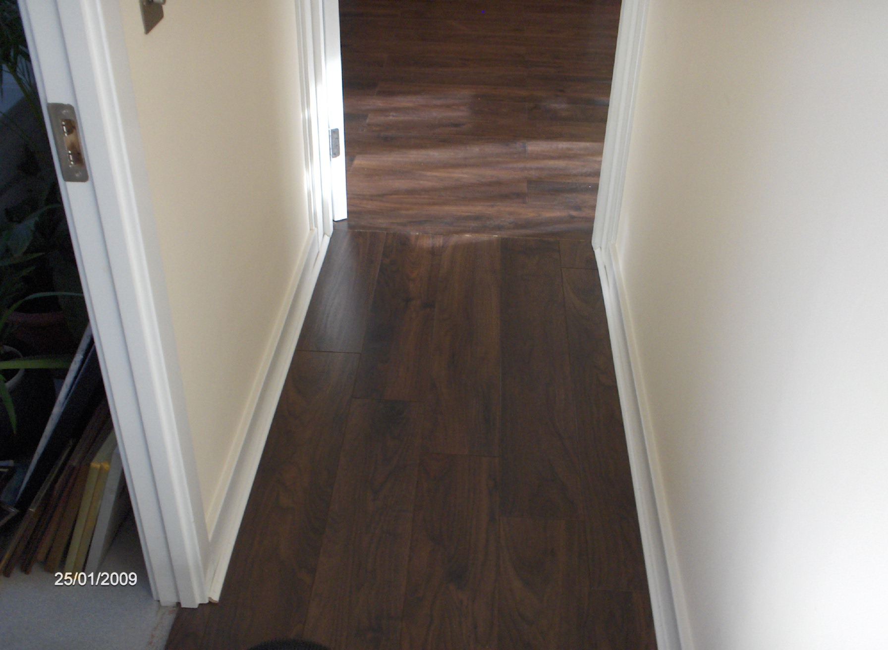 wall nut flooring , carried through into another room