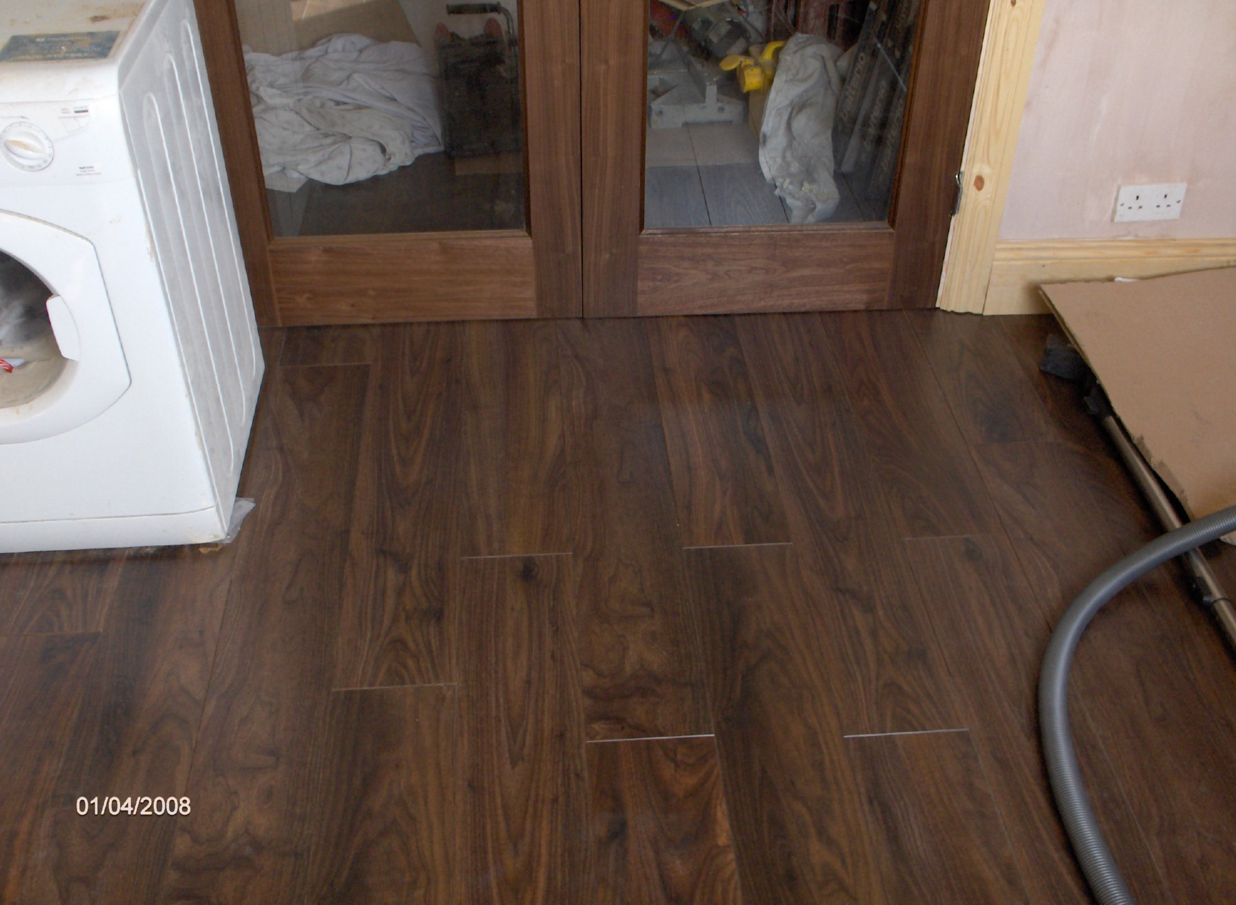 renovation, continued, this is a high quality v-grooved laminate flooring with an acoustic 25db sound proof underlay, really beautiful floor, perfect with the wall nut doors. pleanty of light coming through,