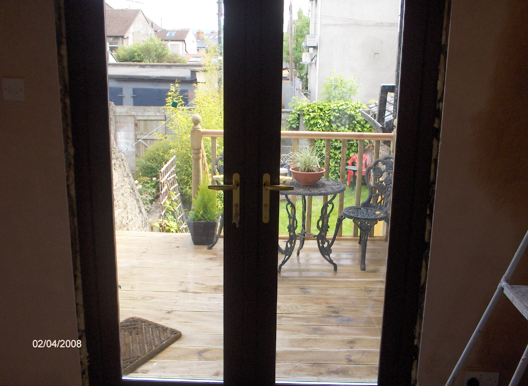 renovation, continued, we had the french doors manufactured with walnut finish on the interior and white on the exterior th keep the inside matching and all the exterior white pvc windows matching,