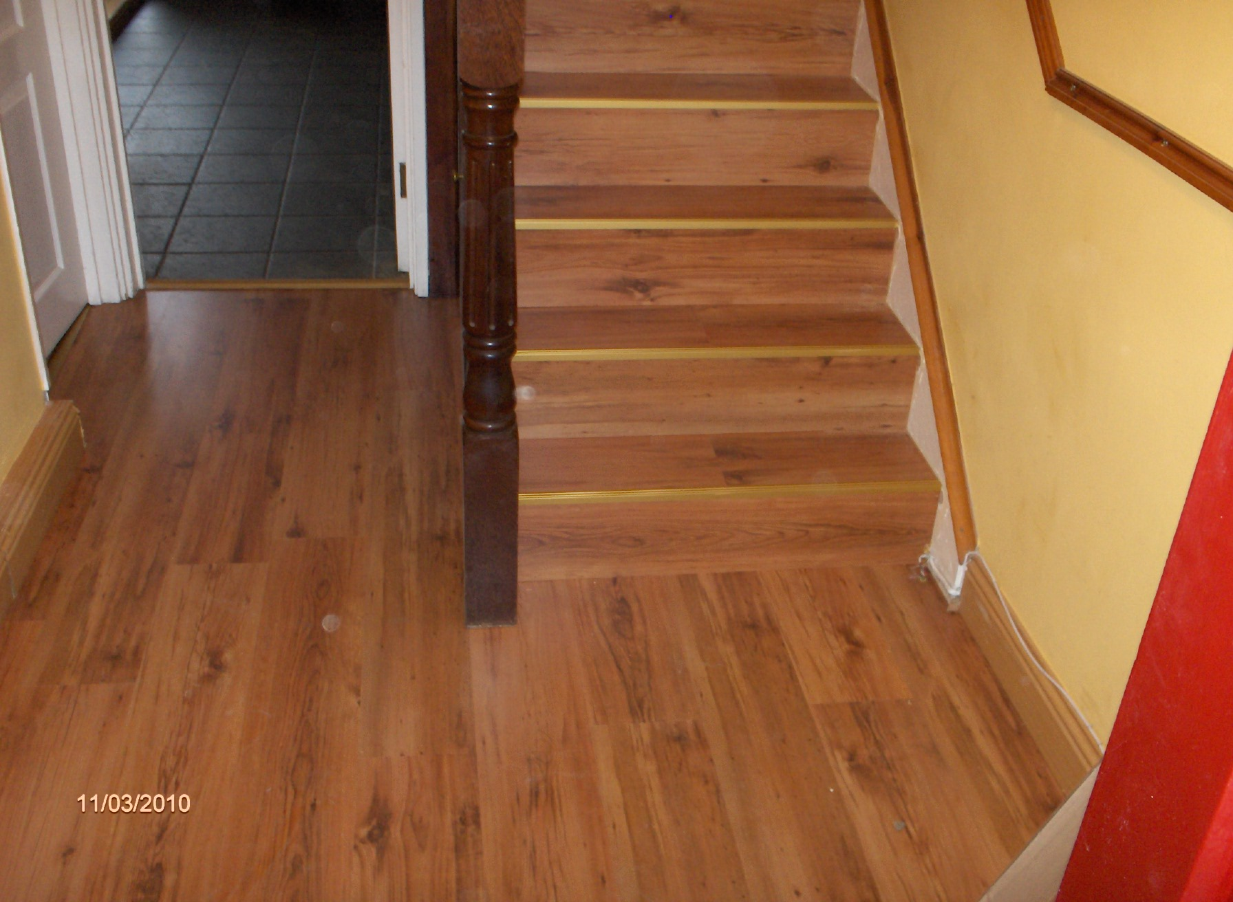 hall stairs and landing done in laminate flooring.