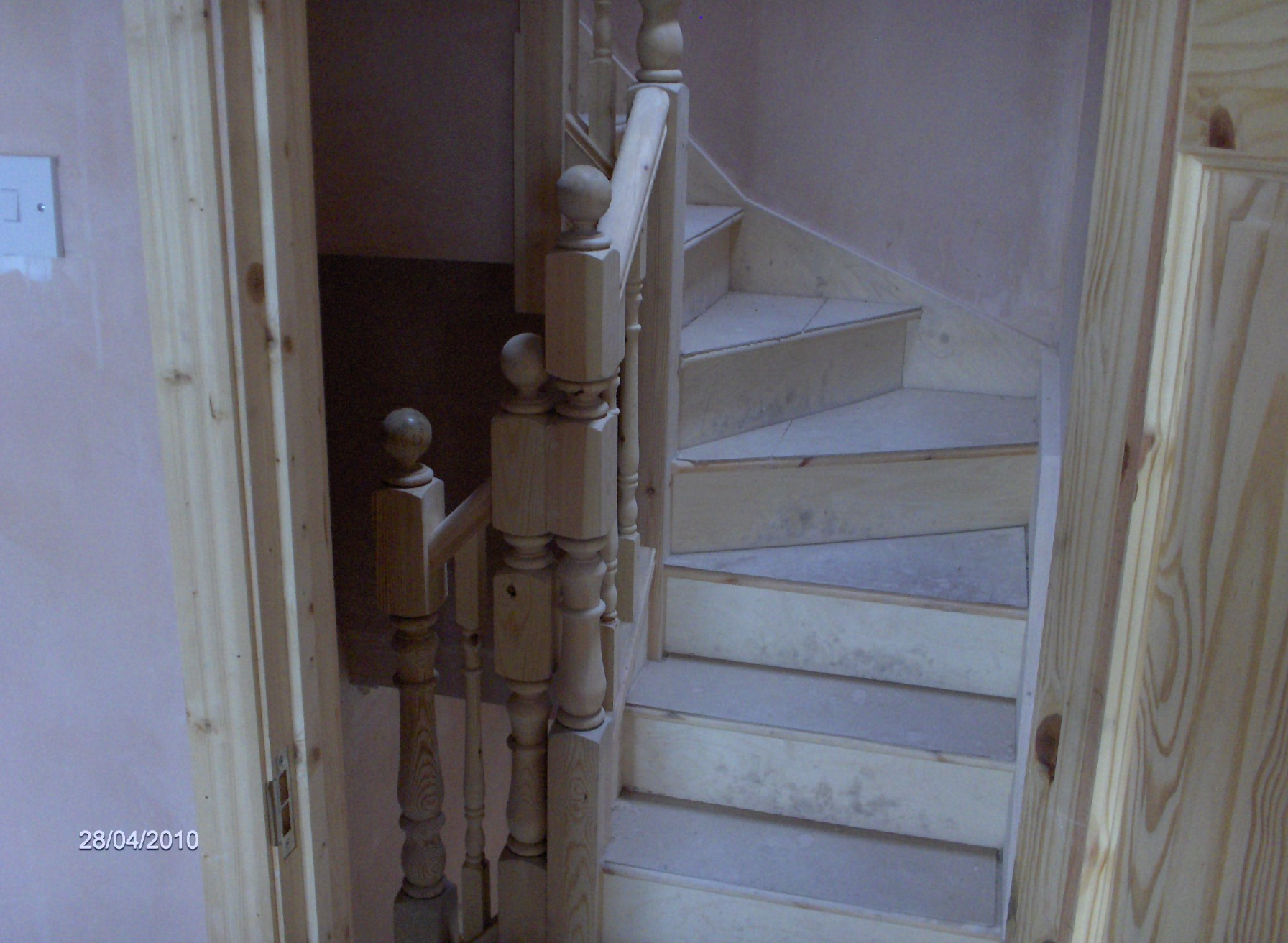 staircase with winder going up to attic,