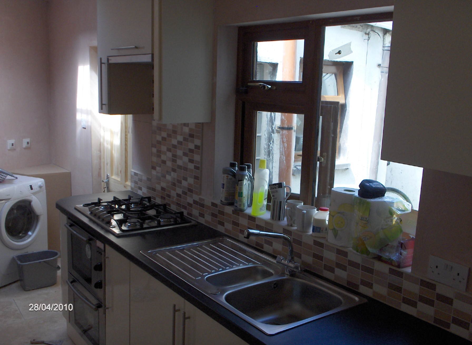 fitted kitchen, with frankie sink, and gas oven and hob