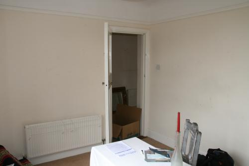 wall before removal and installation of double doors
