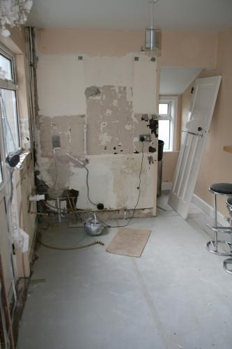 renovation strip out, block up door , install new kitchen
