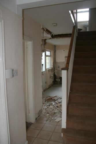 removal of door and wall into kitchen to create open plan area