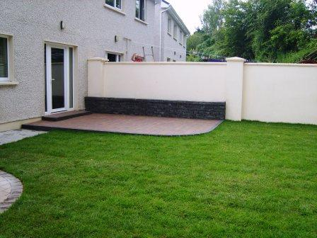 Corrib Curragh Gold Patio with Connemara walling raised bed & new turf lawn.