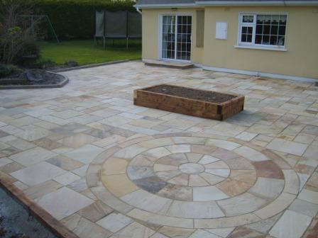 PATIO AREA: TINTED MINT NATURAL STONE WITH CIRCLE