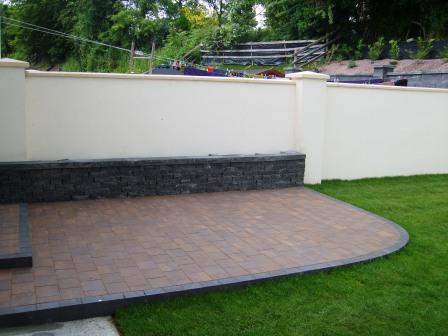 Corrib Curragh Gold Patio with Connemara walling raised bed.