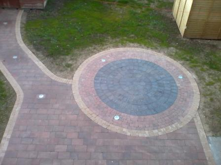 Kingspave rustic maple with tan setts / Damson circle & lights.